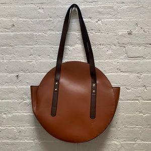 Lightly used circular shoulder bag